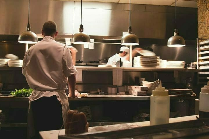 restaurant-commercial-kitchen-chefs-cooking-using-microwave